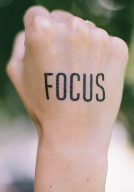 focus word written on fisted hand