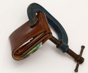 wallet held by a C-clamp